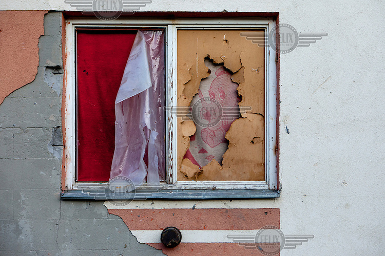 A broken and boarded up window in a flat in Stara Tehelna. This suburb is a segregated district populated by Roma who were moved en mass out of the city centre in 2001
