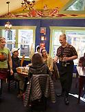 USA, Oregon, Ashland, interior of the colorful Morning Glory Restaurant on Siskiyoui Blvd during breakfast
