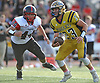 Jason Seiter #23, Bethpage quarterback, right, scrambles for a gain during a Nassau County Conference III varsity football game against Plainedge at Bethpage High School on Saturday, Oct. 21, 2017. Bethpage won by a score of 28-21.