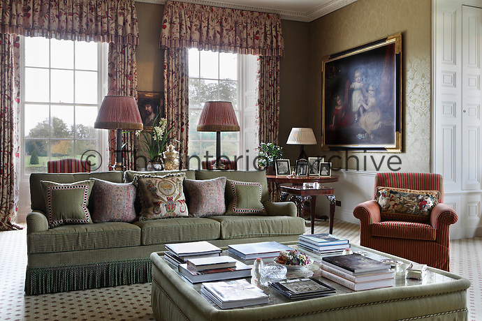 The walls of the sitting room are also covered in a silk damask wallpaper, but In contrast to the drawing room, the feel is more of the nineteenth century, with green tones, a patterend Brussels-weave carpet and curtains of embroidered silk