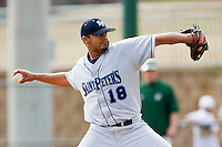 Relief pitcher Randy Reyes #18 of the Saint Peter's Peacocks in action against the Charlotte 49ers at Robert and Mariam Hayes Stadium on February 18, 2012 in Charlotte, North Carolina.  Brian Westerholt / Four Seam Images