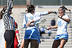 27 February 2016: North Carolina's Sammy Jo Tracy (13) celebrates her goal with Sydney Holman (10) and Molly Hendrick (behind). The University of North Carolina Tar Heels hosted the University of Maryland Terrapins in a 2016 NCAA Division I Women's Lacrosse match. Maryland won the game 8-7.