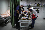 A Palestinian man who was wounded by Israeli troops during clashes at the Israel-Gaza border, in a tent city protest where Palestinians demand the right to return to their homeland, receives treatment at a hospital, in the northern of Gaza Strip on September 21, 2018. Photo by Ramez Habboub