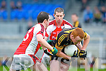 Dr Crokes Johnny Buckley is put under pressure from Rathmore's Micahel O'Riordan and Paul Reen during their Senior Club Championship semi final clash in Fitzgerald Stadium on Saturday
