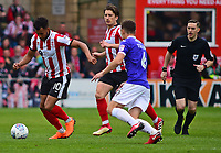 Lincoln City's Matt Green vies for possession with Exeter City's Jordan Tillson<br /> <br /> Photographer Andrew Vaughan/CameraSport<br /> <br /> The EFL Sky Bet League Two Play Off First Leg - Lincoln City v Exeter City - Saturday 12th May 2018 - Sincil Bank - Lincoln<br /> <br /> World Copyright &copy; 2018 CameraSport. All rights reserved. 43 Linden Ave. Countesthorpe. Leicester. England. LE8 5PG - Tel: +44 (0) 116 277 4147 - admin@camerasport.com - www.camerasport.com