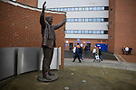 Fans walking past a statue of former owner Jack Walker outside Ewood Park, home of Blackburn Rovers, before the club played host to Aston Villa in a Barclays Premier League match. Blackburn won the match by two goals to nil watched by a crowd of 21,848. It was Rovers' first match under the ownership of Indian company Venky's.