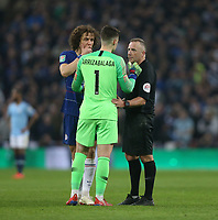 Referee Jon Moss and Chelsea's David Luiz have words with Kepa Arrizabalaga who refused to be substituted <br /> <br /> Photographer Rob Newell/CameraSport<br /> <br /> The Carabao Cup Final - Chelsea v Manchester City - Sunday 24th February 2019 - Wembley Stadium - London<br />  <br /> World Copyright © 2018 CameraSport. All rights reserved. 43 Linden Ave. Countesthorpe. Leicester. England. LE8 5PG - Tel: +44 (0) 116 277 4147 - admin@camerasport.com - www.camerasport.com