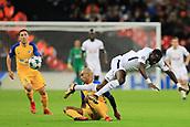 6th December 2017, Wembley Stadium, London England; UEFA Champions League football, Tottenham Hotspur versus Apoel Nicosia; Carlão of Apoel FC tackles Moussa Sissoko of Tottenham Hotspur