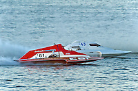 "Mike Weber, E-81 ""Southern Comfort"" (5 Litre class hydroplane) and Jim Martin, E-43 ""Keen's Sunday Money"" (5 Litre class hydroplane)."