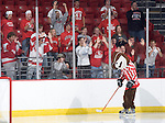MADISON, WI - SEPTEMBER 29: Fans of the Wisconsin Badgers women's hockey team cheer during the game with mascot Bucky Badger against the Quinnipiac Bobcats at the Kohl Center on September 29, 2006 in Madison, Wisconsin. The Badgers beat the Bobcats 3-0. (Photo by David Stluka)