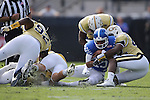 Quarterback Stephen Johnson #15 of the Kentucky Wildcats is tackled by defensive end KeShun Freeman #42 of the Georgia Tech Yellow Jackets during the first half of the TaxSlayer Bowl at EverBank Field on Saturday, December 31, 2016 in Jacksonville, Florida. Photo by Michael Reaves | Staff.