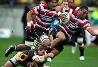 Wellington flanker Scott Fuglistaller tackles Siale Piutau. ITM Cup - Wellington Lions v Counties-Manukau Steelers at Westpac Stadium, Wellington, New Zealand on Sunday, 8 August 2010. Photo: Dave Lintott/lintottphoto.co.nz.