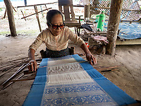 A women from the Khamee tribe weaving, Mrauk U, Rakhine State, Myanmar