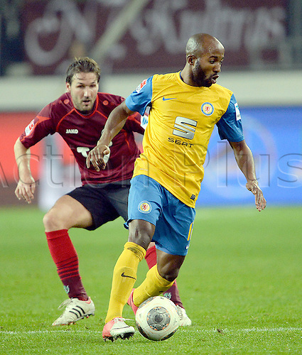 08.11.2013. Hanover, Germany.  Hanover's Christian Schulz  (L) and Braunschweig's Domi Kumbela challenge for the ball during the Bundesliga soccer match between Hannover 96 and Eintracht Braunschweig in Hanover, Germany, 8 November 2013.