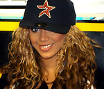 Beyonce Knowles of Destiny's Child wears a Houston Astros cap  backstage at the104 KRBE Jingle Jam 2002 Thursday Dec. 5,2002 at the Compaq Center.
