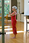 Mature woman exercising, side view