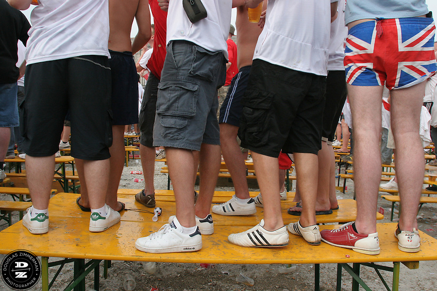 An English National Soccer Team supporters proudly shows his allegance to the United Kingdom and the England National Team while standing on a table during England's 2006 FIFA World Cup first round match against Trinadad and Tobago at the Nuremburg Fan Festival just outside the Nuremburg World Cup stadium on Thursday, June 15h, 2006.  Many fans were forced to stand on top of tables and benches to be able to get a clear view of the large television screen which showed the match live.