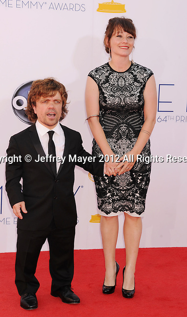 LOS ANGELES, CA - SEPTEMBER 23: Peter Dinklage and Erica Schmidt  arrive at the 64th Primetime Emmy Awards at Nokia Theatre L.A. Live on September 23, 2012 in Los Angeles, California.