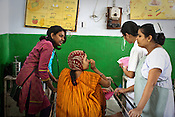 Nurses help translate while Doctor Blessy Joseph (left) consults a young woman whose child was born with muscular complications in the pediatrics ward of the Duncan Hospital in Raxaul of East Champaran district of Bihar, India. Since 2008 the Foundation and Geneva Global have been investing in the training of medical staff to improve the lives of people living in 600+ villages in the region. The NGOs are delivering cost effective interventions to address treatment, care and prevention of diseases, disability and preventable deaths amongst infants, adolescent girls and women of child-bearing age. There is statistical and anecdotal evidence that there have been vast improvements and a total of 40-50% increased immunization for all children under 6 has meant that communities can be serviced and educated long term. Photograph: Sanjit Das/Panos for Legatum Foundation