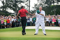 Tiger Woods (USA) celebrates with caddy Joe LaCavs after sinking his putt to win The 2019 Masters , Augusta National, Augusta, Georgia, USA. 14/04/2019.<br /> Picture Fran Caffrey / Golffile.ie<br /> <br /> All photo usage must carry mandatory copyright credit (© Golffile | Fran Caffrey)