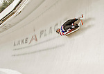 """5 December 2015: Summer Britcher, competing for the United States of America, slides through Curve 10 """"Shady"""" on her first run of the Viessmann World Cup Women's Luge at the Olympic Sports Track in Lake Placid, New York, USA. Britcher ended the day with a combined run-time of 1:28.221, giving her a third place win. Mandatory Credit: Ed Wolfstein Photo *** RAW (NEF) Image File Available ***"""