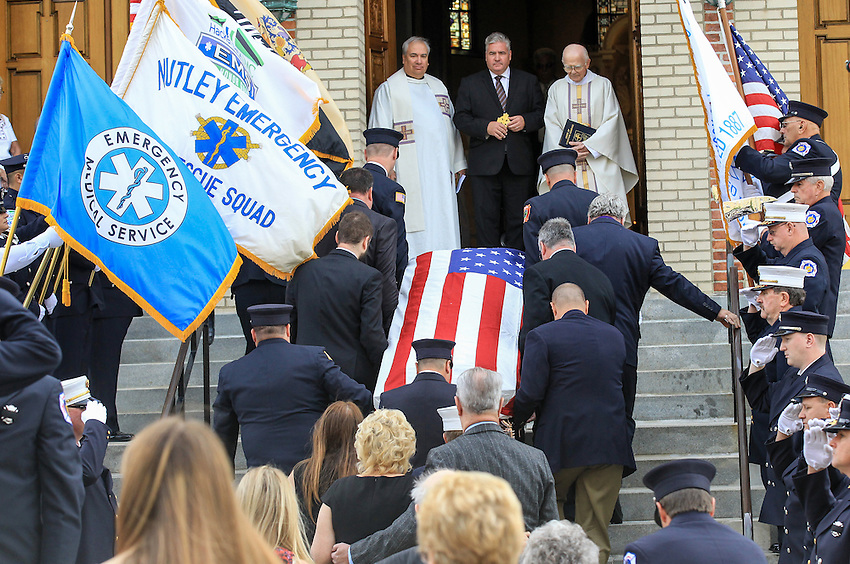 The casket containing the remains of longtime firefighter EMT Dan McCann is carried into St. Cecilia's Church in Kearny for his funeral mass. McCann, a firefighter EMT with more than 25 years experience, died last week after a fire department training exercise in Manasquan.  9/21/16  (Andrew Mills | NJ Advance Media for NJ.com)