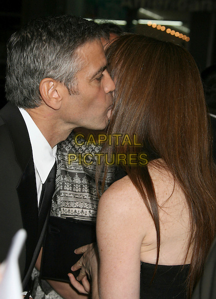 "GEORGE CLOONEY & SARAH LARSON .""Leatherheads"" World Premiere held at Grauman's Chinese Theatre, Hollywood, California, USA,.31 March 2008..portrait headshot kissing profile girlfriend couple profile .CAP/ADM/RE.©Russ Elliot/Admedia/Capital PIctures"