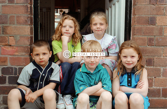 Group of children sitting on doorstep,