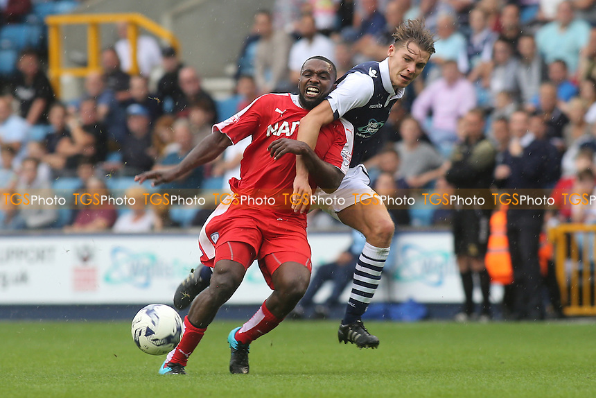 Chesterfield's Sylvan Ebanks-Blake tries to shake off a challenge from Millwall's Sid Nelson during Millwall vs Chesterfield, Sky Bet League 1 Football at The Den, London, England on 29/08/2015