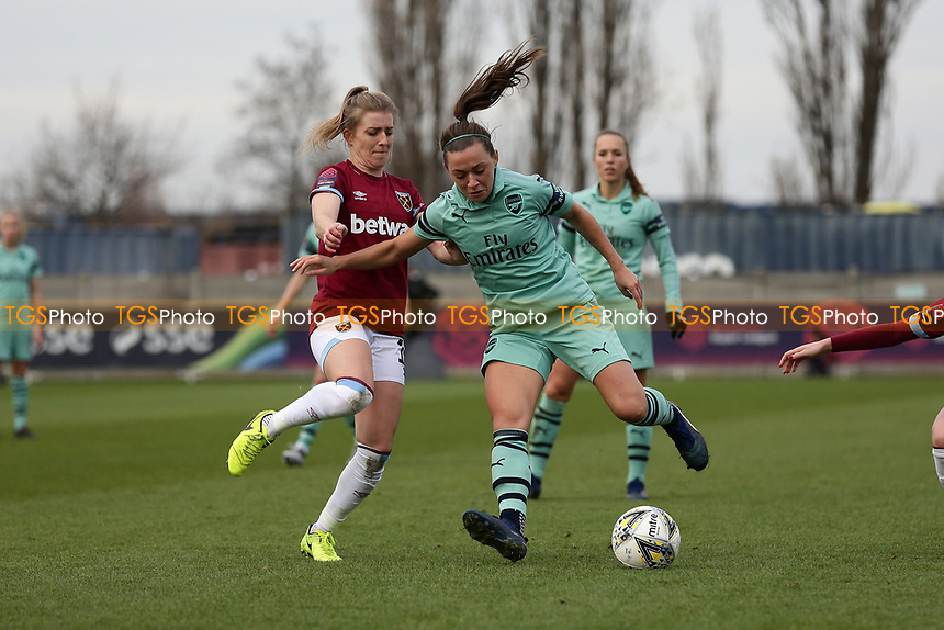 Katie McCabe of Arsenal and Kate Longhurst of West Ham during West Ham United Women vs Arsenal Women, FA Women's Super League Football at Rush Green Stadium on 6th January 2019
