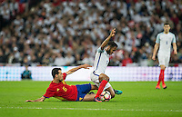 Sergio Busquets of Spain brings down Raheem Sterling (Man City) of England during the International Friendly match between England and Spain at Wembley Stadium, London, England on 15 November 2016. Photo by Andy Rowland.