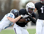 SIOUX FALLS, SD - OCTOBER 27: Michael Maxwell #1 from the University of Sioux Falls tries to break free from Tanner Thompson #29 from Upper Iowa during their game Saturday at Bob Young Field in Sioux Falls. (Photo by Dave Eggen/Inertia)