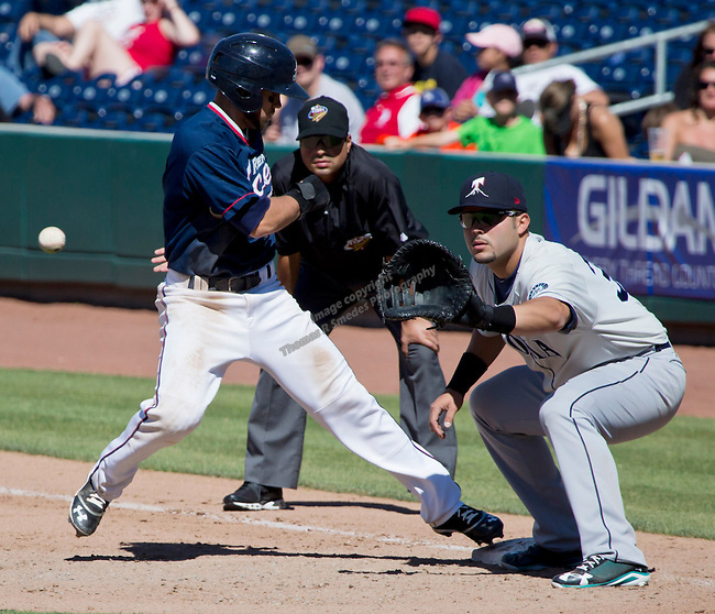Reno Aces Chris Owings scrambles to get back to first base against the Tacoma Rainiers during their game played on Sunday afternoon, May 26, 2013 in Reno, Nevada.