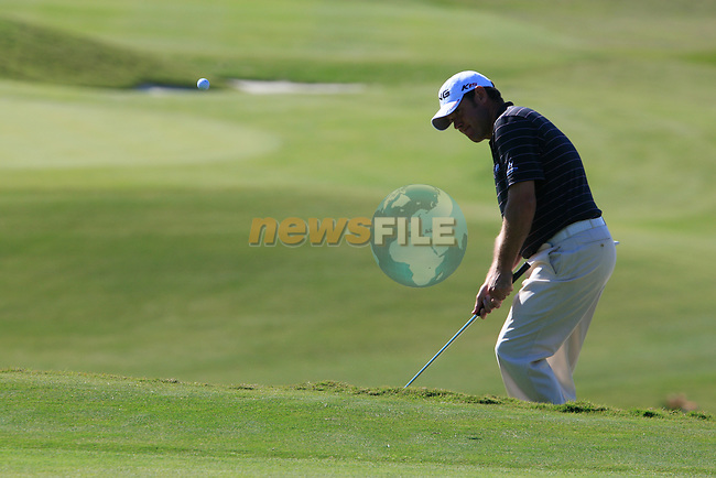 Lee Westwood (ENG) chips onto the 6th green during the morning session on Day 3 of the Volvo World Match Play Championship in Finca Cortesin, Casares, Spain, 21st May 2011. (Photo Eoin Clarke/Golffile 2011)