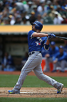 OAKLAND, CA - JULY 23:  Danny Valencia #23 of the Toronto Blue Jays bats against the Oakland Athletics during the game at O.co Coliseum on Thursday, July 23, 2015 in Oakland, California. Photo by Brad Mangin