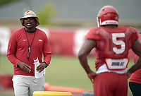 NWA Democrat-Gazette/ANDY SHUPE<br /> Arkansas assistant coach John Scott Jr. leads his players through a drill Tuesday, Aug. 7, 2018, during practice at the university practice fields in Fayetteville. Visit nwadg.com/photos to see more photographs from the practice.