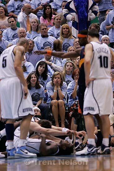 Fans react to Utah Jazz guard Dee Brown's collision with teammate Utah Jazz center Mehmet Okur (13), of Turkey, Salt Lake City - Utah Jazz vs. Golden State Warriors, NBA Playoffs basketball, second round, Game Two, at EnergySolutions Arena. fans