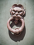 Face and ring, ornamental door knocker, Ravenna, Italy