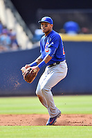 Chicago Cubs shortstop Addison Russell (27) fields the ball during a game against the Atlanta Braves at Turner Field on June 11, 2016 in Atlanta, Georgia. The Cubs defeated the Braves 8-2. (Tony Farlow/Four Seam Images)