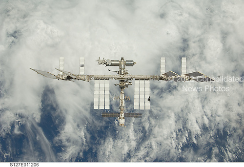 In Earth Orbit - July 28, 2009 -- Backdropped by a blue and white Earth, the International Space Station is seen from Space Shuttle Endeavour as the two spacecraft begin their relative separation. Earlier the STS-127 and Expedition 20 crews concluded 11 days of cooperative work onboard the shuttle and station. Undocking of the two spacecraft occurred at 12:26 p.m. (CDT) on July 28, 2009.Credit:  NASA via CNP