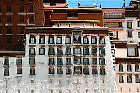 """The thirteen-story Potala Palace is composed of the White Palace and the Red Palace. Work began on the White Palace in 1645 when the fifth Dalai Lama decided to move his government from the Drepung monastery to the heart of Lhasa high on the terraced slope of the 130-meter """"Red Hill."""""""
