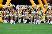 The Washington Redskins cheerleaders run onto the field prior to the game against the Buffalo Bills at FedEx Field in Landover, Maryland on Friday, August 13, 2010.  The Redskins won the game 42 - 17..Credit: Ron Sachs / CNP