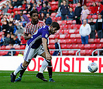 Ched Evans of Sheffield Utd challenged by Brendan Galloway of Sunderland during the Championship match at the Stadium of Light, Sunderland. Picture date 9th September 2017. Picture credit should read: Simon Bellis/Sportimage