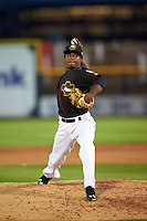 Quad Cities River Bandits pitcher Angel Heredia (14) delivers a pitch during the first game of a doubleheader against the Wisconsin Timber Rattlers on August 19, 2015 at Modern Woodmen Park in Davenport, Iowa.  Quad Cities defeated Wisconsin 3-2.  (Mike Janes/Four Seam Images)