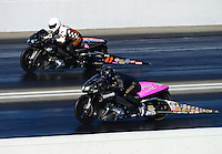 Nov. 10, 2012; Pomona, CA, USA: NHRA pro stock motorcycle rider Jim Surber (far lane) races alongside Redell Harris during qualifying for the Auto Club Finals at at Auto Club Raceway at Pomona. Mandatory Credit: Mark J. Rebilas-