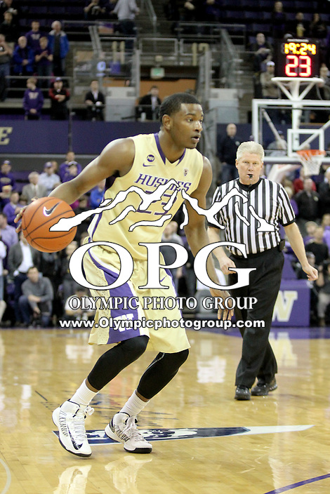 March 03, 2014:  Washington's C.J. Wilcox sets up to make his move to the basket against UCLA. UCLA defeated Washington 91-82 at Alaska Airlines Arena in Seattle, Washington.