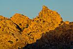 Sunset light on boulder rock peak outcrop, near Quail Springs, Joshua Tree National Park, California