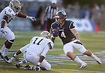 Nevada running back Kendall Brock runs up the middle against UC Davis defenders Walter Ernest and Jonathan Perkins during the first half of a college football game in Reno, Nev., on Saturday, Sept. 7, 2013. (AP Photo/Cathleen Allison)