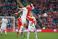 Guram Kashia of Georgia and Sam Vokes of Wales with James Chester of Wales during the FIFA World Cup Qualifier match between Wales and Georgia at the Cardiff City Stadium, Cardiff, Wales on 9 October 2016. Photo by Mark  Hawkins / PRiME Media Images.