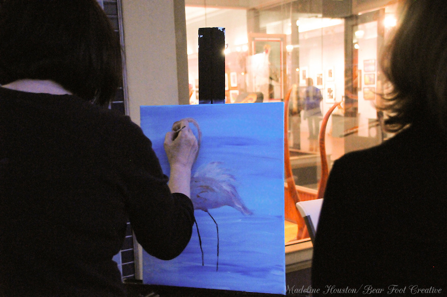 Artist Sue Wachter participates in the dueling flamingos paint-off, organized by the Rectangle Gallery during Centralia, Washington's Third Thursday on September 15, 2016.